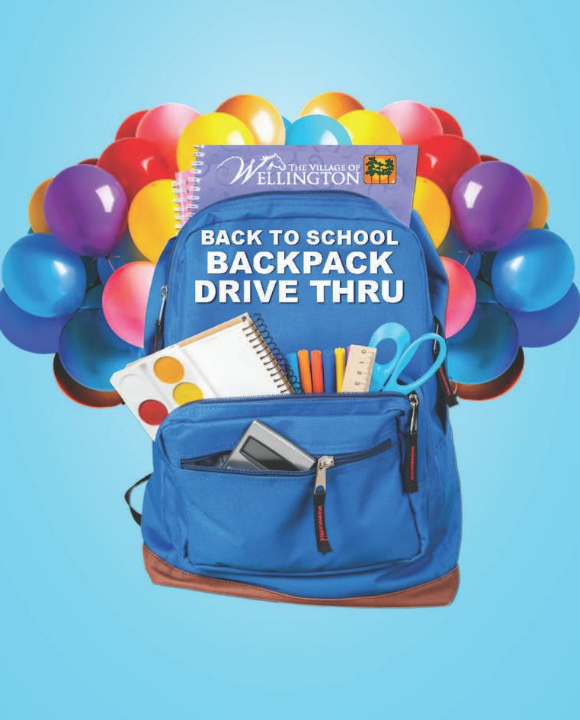 Backpack filled with school supplies in front of colorful balloons